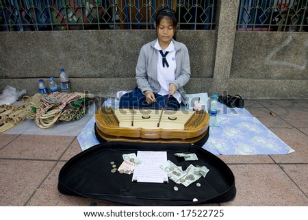 BANGKOK - JULY 19: Student begs for education on chatuchak weekend market July 19 in Bangkok, Thailand - stock photo