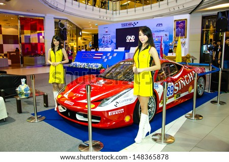 BANGKOK - JULY 31 :  Unidentified model with car on Press conference of Flat race cars on display at Thailand Super Series 2013 Course 3 and 4 on July 31, 2013 in Bangkok, Thailand