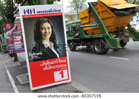 BANGKOK - JUNE 25: A roadside election campaign placard endorsing Pheu Thai Party and its leader Yingluck Shinawatra June 25, 2011 in Bangkok, Thailand. Thais go to the polls on 3rd July.