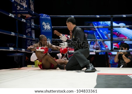 "BANGKOK - JUNE 9: Muay Thai Super Welterweight World Championship - Alejandro Asumu Osa (ES) got knocked out by Kem Sitsongpeenong (TH) at ""BATTLE FOR THE BELTS"" on June 9, 2012 in Bangkok, Thailand"