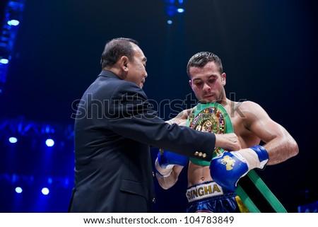 "BANGKOK - JUNE 9: Muay Thai Welterweight World Champion Fabio Pinca (France) receiving the belt at ""BATTLE FOR THE BELTS"" event on June 9, 2012 in Bangkok, Thailand"