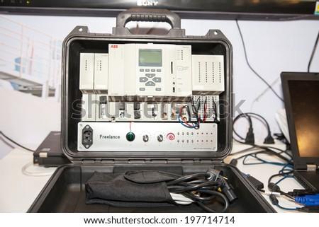 BANGKOK - JUNE 4 : Tele controller box in hand at Renewable Energy Environmental Technology  on June 4,2014 in BITEC ,Bangkok, Thailand.