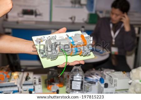 BANGKOK - JUNE 4 : Telecontroller box in hand at Renewable Energy Environmental Technology on June 4,2014 in BITEC ,Bangkok, Thailand.
