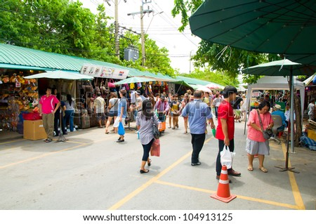 BANGKOK - JUNE 10:  Tourist shopping in Chatuchak weekend market on June 10, 2012 in Bangkok, Thailand  Open 8am - 6pm  Sat   Sun , It is the largest market in Thailand - stock photo