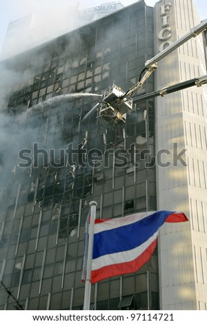 BANGKOK - MAR 5: Firefighters tackle a blaze at Fico Building on Asoke Road in the city centre on Mar 5, 2012 in Bangkok, Thailand. The BMA has launched an investigation in the cause of the blaze.