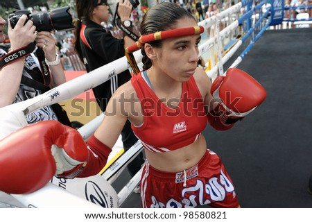 BANGKOK - MARCH 23: An unidentified female Muay Thai fighter warms up before a match in the World Amateur Muay Thai Championships at the National Stadium on March 23, 2012 in Bangkok, Thailand.
