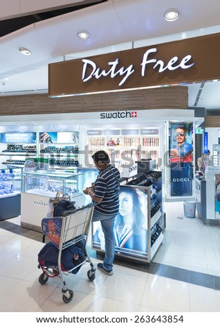 BANGKOK - MARCH 18; 2015: An unidentified man shops at a duty free watches shop at the International Airport Suvarnabhumi which is the sixth busiest airport in Asia.