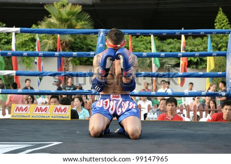 BANGKOK - MARCH 20: An unidentified Muay Thai fighter warms up before a match in the World Amateur Muay Thai Championships at the National Stadium on March 20, 2012 in Bangkok, Thailand. - stock photo