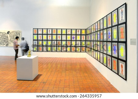 BANGKOK - MARCH 7: People look at painting and sculpture during Thai Contemporary Art Exhibition on March 7, 2015 at The National Gallery in Bangkok, Thailand.
