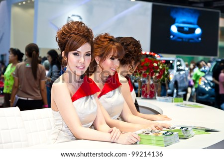 BANGKOK - MARCH 31: Unidentified female presenters model at the Nissan booth during the Thailand International Motor Expo at Impact Muang Thong Thani on March 31, 2012 in Bangkok, Thailand.