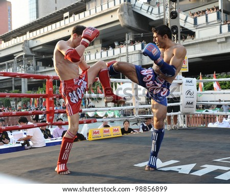 BANGKOK - MARCH 20: Unidentified Muay Thai fighters compete in the World Amateur Muay Thai Championships at the National Stadium on March 20, 2012 in Bangkok, Thailand.