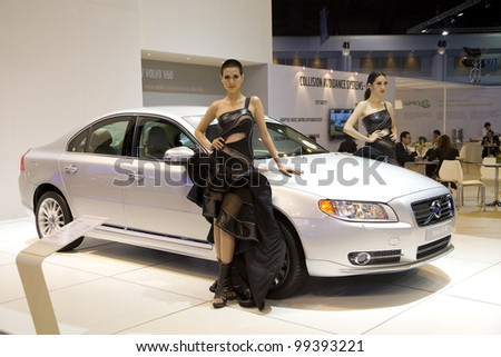 BANGKOK - MARCH 27: Volvo S 80 car with unidentified model on display at The 33th Bangkok International Motor Show on March 27, 2012 in Bangkok, Thailand.