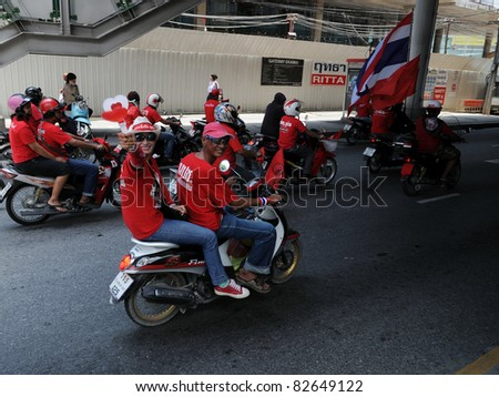 BANGKOK - MAY 19: A convoy of red-shirt protesters ride to Ratchaprasong on May 19, 2011 in Bangkok, Thailand. The red-shirts gathered to mark one year since 91 people died in protests in the capital.