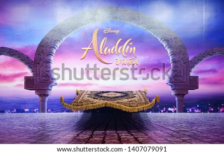 Bangkok - May 25, 2019 : A photo of movie standee of a magic carpet in front of a twilight scene in Aladdin to promote the movie Aladdin (2019) in theatre in 22 May 2019.