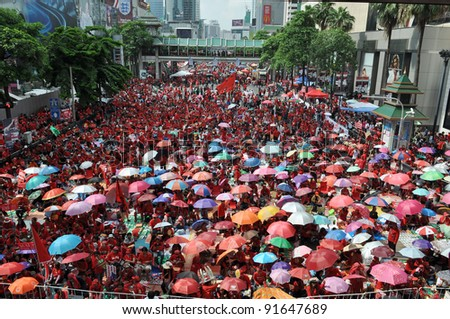 BANGKOK - MAY 19: An estimated 30,000 red-shirt protesters gather at Ratchaprasong Junction to remember those killed in political violence in the previous year on May 19, 2011 in Bangkok, Thailand.