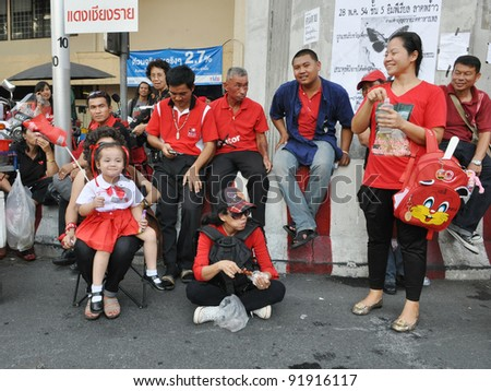 BANGKOK - MAY 19: Red-shirt protesters gather at Ratchaprasong Junction to mark a year since 91 people died in violent anti-government clashes in the Thai capital on May 19, 2011 in Bangkok, Thailand.