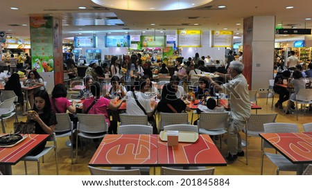BANGKOK - MAY 7: Unidentified people eat at a food court in Platinum Fashion Mall on May 7, 2013 in Bangkok, Thailand. Platinum houses over 2000 shops featuring clothes and accessories. - stock photo