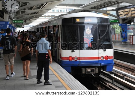 BANGKOK - NOV 28: A BTS Skytrain pulls into a station in the city centre on Nov 28, 2012 in Bangkok, Thailand. Each train of the mass transport rail network can carry over 1,000 passengers.