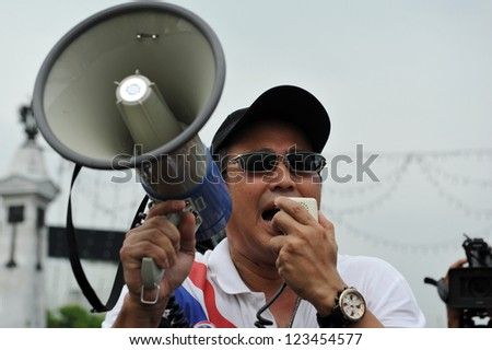 BANGKOK - NOV 24: A protest leader from the nationalist Pitak Siam movement uses a loud hailer to direct protesters during a large anti government rally on Nov 24, 2012 in Bangkok, Thailand.