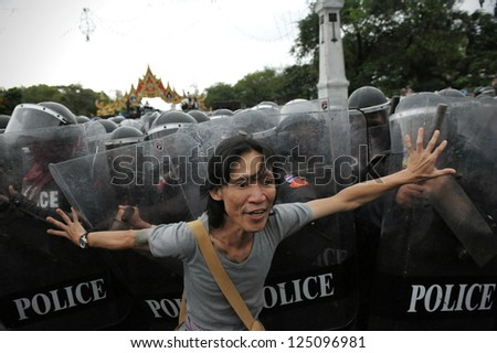BANGKOK - NOV 24: A protester from the nationalist Pitak Siam movement confronts riot police during a violent anti-government rally on Nov 24, 2012 in Bangkok, Thailand.