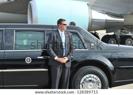 BANGKOK - NOV 18: An unidentified body guards waits by the Presidential State Car at Don Muang Airport as President Barack Obama begins a historic SE Asia tour on Nov 18, 2012 in Bangkok, Thailand.