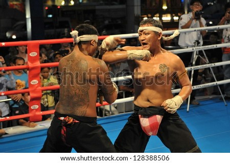 BANGKOK - NOV 21: Fighters take part in a Muay Boran demonstration at MBK Fight Night on Nov 21, 2012 in Bangkok, Thailand. Muay Boran refers to Thai kickboxing before modern rules were introduced.