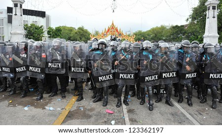 BANGKOK - NOV 24: Riot police stand guard on Makhawan Bridge during a violent anti-government rally on Nov 24, 2012 in Bangkok, Thailand. Protesters and police clashed repeatedly with dozens injured.