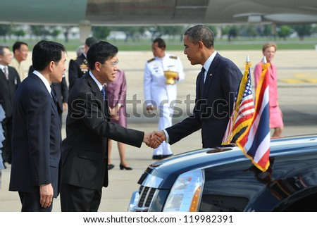 BANGKOK - NOV 18: US President Barack Obama is greeted by a government official as he arrives at Don Muang International Airport on a historic Southeast Asia tour on Nov 18, 2012 in Bangkok, Thailand.