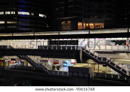BANGKOK - NOVEMBER 26:  Night scene of BTS Skytrain station on November 26, 2011 in Bangkok, Thailand. Open 6 am – 12 pm. Sukhumvit & Silom Line connect at Siam Station where passengers can transfer.