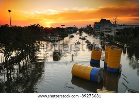 BANGKOK - NOVEMBER 21: Unidentified truck trying to get through high level water flood on Petchakasem RD. during Thai flood crisis on November 21, 2011. The area is Thonburi side of Bangkok, Thailand.