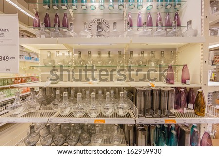 BANGKOK - OCTOBER 23: Glass ware on the shelf in IKEA Bangkok Store on October 23, 2013 in Mega Bangna, Bangkok. Founded in Sweden in 1943, Ikea is the world\'s largest furniture retailer.
