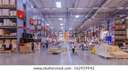 BANGKOK - OCTOBER 23: People pick up furniture component from the shelf at IKEA Bangkok Store on October 23, 2013 in Bangkok. Founded in Sweden in 1943, Ikea is the world\'s largest furniture retailer.