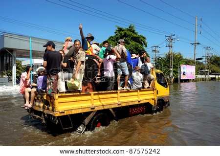 BANGKOK - OCTOBER 28: Villagers going home on the truck during the flooding of October 28, 2011 in Bangkok, Thailand.