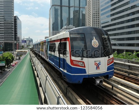 BANGKOK - SEPT 12: A BTS Skytrain on elevated rails in Sathorn district on Sept 12, 2012 in Bangkok, Thailand. Each train of the mass transport rail network can carry over 1,000 passengers.