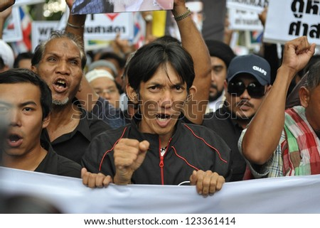BANGKOK - SEPT 18: A large crowd of Muslims rally outside the American Embassy protesting against the controversial film Innocence of Muslims on September 18, 2012 in Bangkok, Thailand. - stock photo