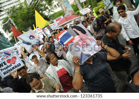 BANGKOK - SEPT 18: A large crowd of Muslims rally outside the American Embassy protesting against the controversial film Innocence of Muslims on September 18, 2012 in Bangkok, Thailand.