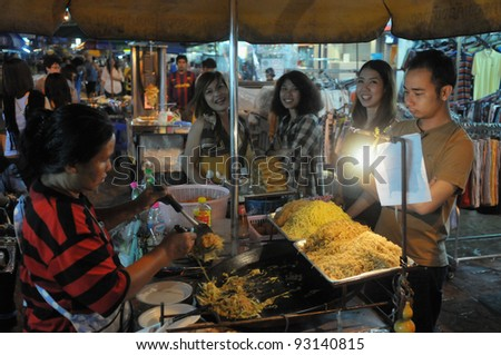 BANGKOK - SEPT 10: An unidentified street vendor cooks noodles on Khao San Road on Sept 10, 2011 in Bangkok, Thailand. There are 16,000 registered street vendors in Bangkok according to the BMA.