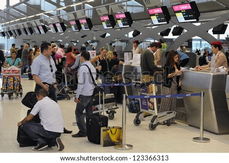 BANGKOK - SEPT 19: Passengers arrive at check-in counters at Suvarnabhumi Airport on Sept 19, 2012 in Bangkok, Thailand. The airport handles 45 million passengers annually.