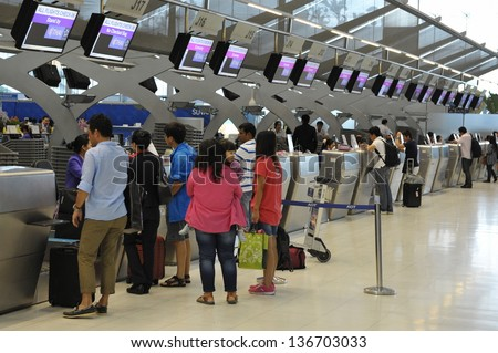 BANGKOK - SEPT19: Passengers arrive at check-in counters at Suvarnabhumi Airport on Sept 19, 2012 in Bangkok, Thailand. The airport is one of the busiest in Asia, handling 45mn travellers annually.