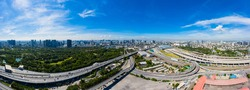 Bangkok skyline with new Bang Sue Grand Station in Bangkok, Thailand. Aerial view of Passenger and freight trains. Expressway top view