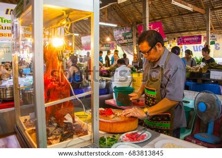 Bangkok, THAILAND -April 04 2017 - A man sell roasted duck at local flea market #683813845