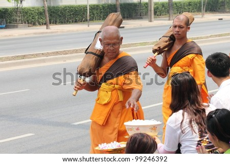 BANGKOK,THAILAND-APRIL 3: Monks walking for praying to king of Thailand on April 3, 2012 in  Bangkok,Thailand . 90% of the Thai  population is Buddhist