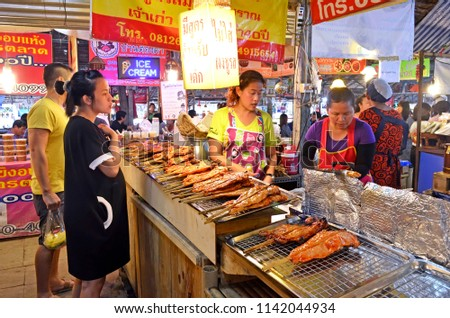 Bangkok, Thailand - April 25, 2015: Take away food stall at Khlong Lat Mayom floating market, a place where Bangokian families like to spend several hours during the week-end. #1142044934