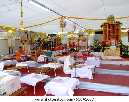BANGKOK, THAILAND - APRIL 03: Thai Buddhist monks sit and write and chant inside a tent at a Buddhist festival in Suan Luang. April 03 2007 in Bangkok.