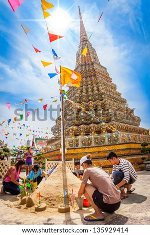 BANGKOK,THAILAND - APRIL 13: Thai people come to build the Sand Pagoda for return the sand to the temple on Songran festival at Pho temple on April 13,2013 in Bangkok,Thailand