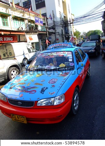 BANGKOK, THAILAND - APRIL 3: Thai taxi decorated to attract tourists driving on the road on April 3, 2007 in Bangkok.