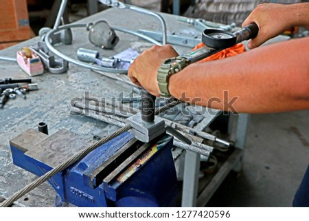 BANGKOK-THAILAND-APRIL 4 : Tool torque of Steel hardware for fitting electrical cable with steel tower in Transmission line of Thailand, April 4, 2018 Bangkok, Thailand #1277420596