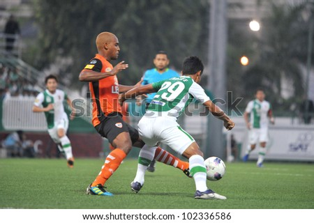 BANGKOK THAILAND - APRIL 22 : unidentified player in Thai Premier League (TPL) between Bangkok Glass FC (G) VS Changrai UTD. (O) at LEO stadium on April 22,2012 in Bangkok,Thailand.
