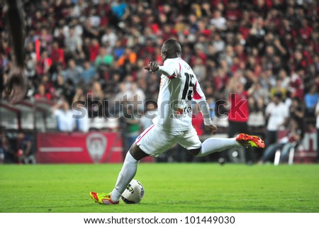 BANGKOK, THAILAND - APRIL 29: Unidentified player in Thai Premier League (TPL) between Muangtong UTD. (R) VS BBCU FC (W) at SCG stadium on April 29, 2012 in Bangkok,Thailand.