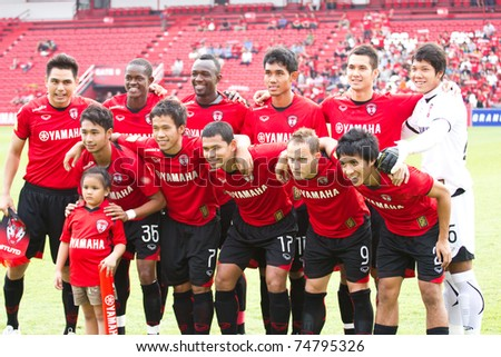 BANGKOK THAILAND - APRIL 6 : Unidentified players in Thai Premier League (TPL) between Muang Thong utd (red) vs TTM PHICHIT (yellow)  on April 6, 2011 at Yamaha Stadium Bangkok, Thailand